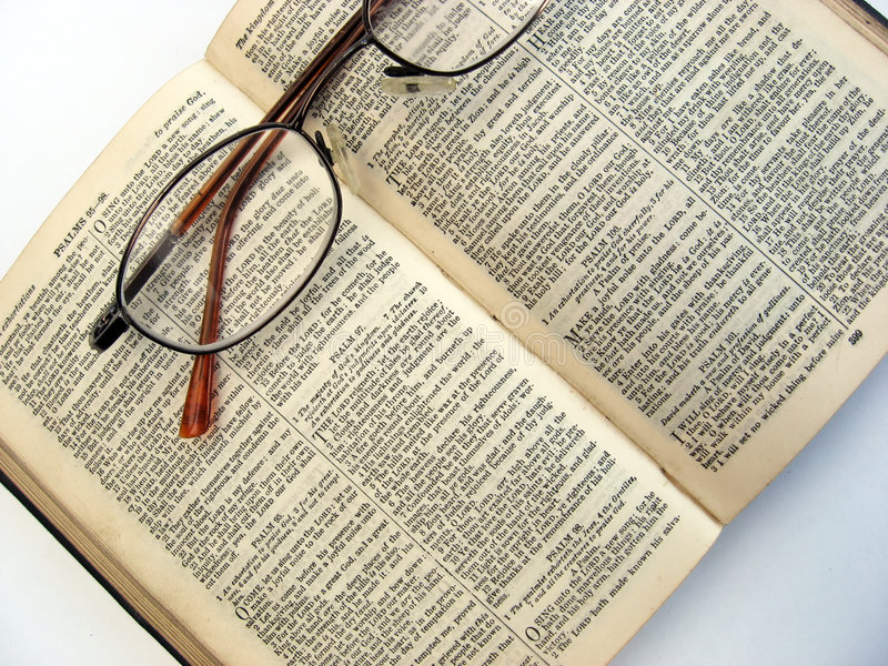 Open book and glasses. Open book with glasses on a plain background stock photo