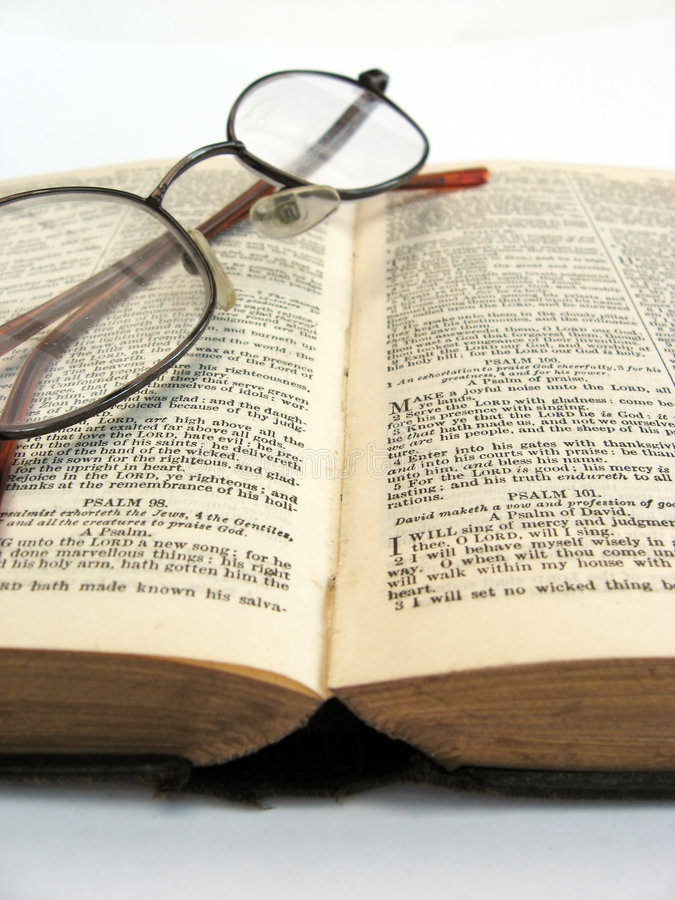 Open book and glasses. Open book with glasses on a plain background royalty free stock photography