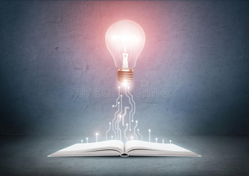 Open book and glowing light bulb over it. Knowledge, education concept. Open book and glowing light bulb over it. Knowledge and education concept royalty free stock images