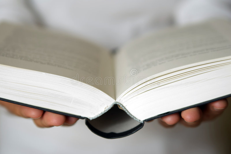 Open book in hands stock image
