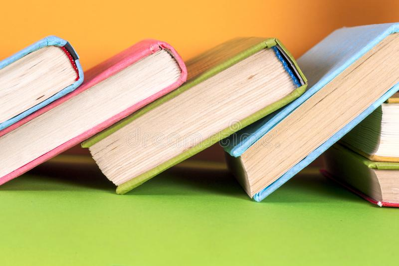 Open book, hardback books on bright colorful background. Back to school. Copy space for text royalty free stock images