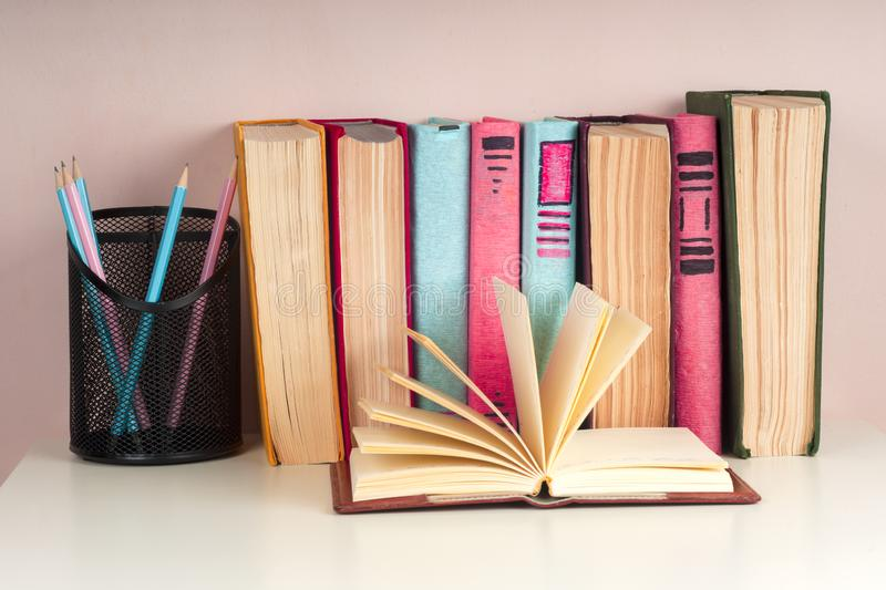 Open book, hardback books on bright colorful background. Back to school. Copy space for text stock photos