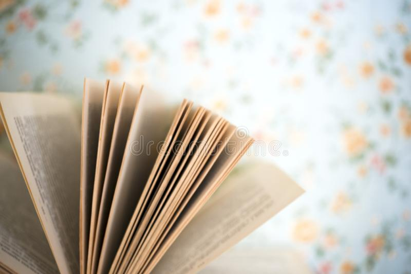 Open book, hardback books on bright colorful background. royalty free stock photography