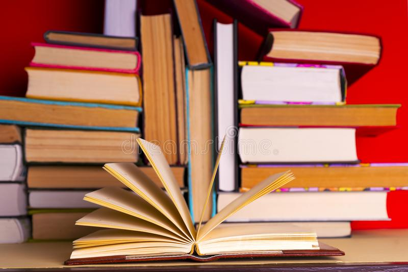 Open book, hardback books on bright colorful background. Back to school. Copy space for text. Set of books in the library. Knowledge, Science royalty free stock photos