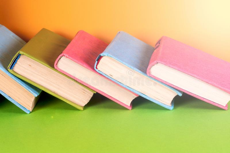 Open book, hardback books on bright colorful background. Back to school. Copy space for text stock photography