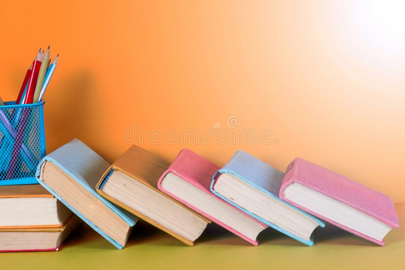 Open book, hardback books on bright colorful background. Back to school. Copy space for text stock image
