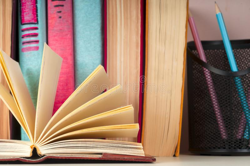 Open book, hardback books on bright colorful background. Back to school. Copy space for text royalty free stock image