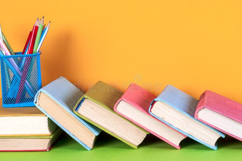 Open book, hardback books on bright colorful background. Back to school. Copy space for text royalty free stock photos