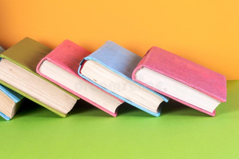Open book, hardback books on bright colorful background. Back to school. Copy space for text royalty free stock photo
