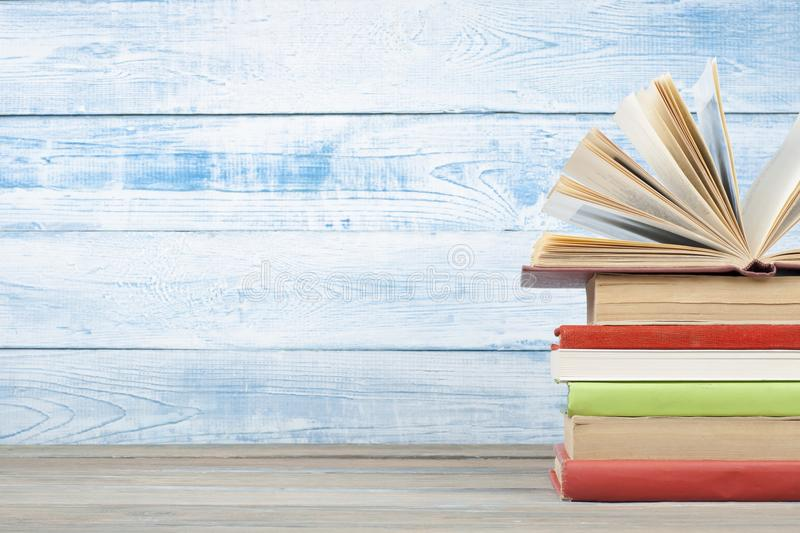 Open book, hardback books on wooden table. Education background. Back to school. Copy space for text. Open book, hardback books on wooden table. Back to school stock image