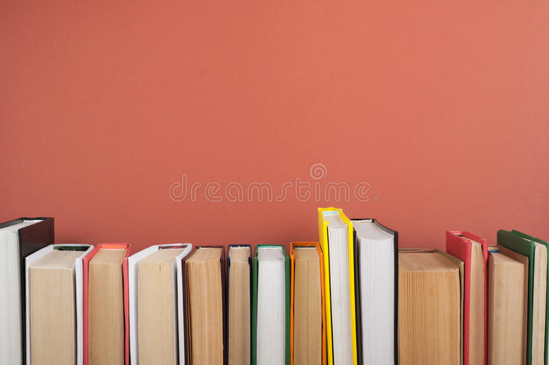 Open book, hardback colorful books on wooden table. Back to school. Copy space for text. Education business concept. stock images
