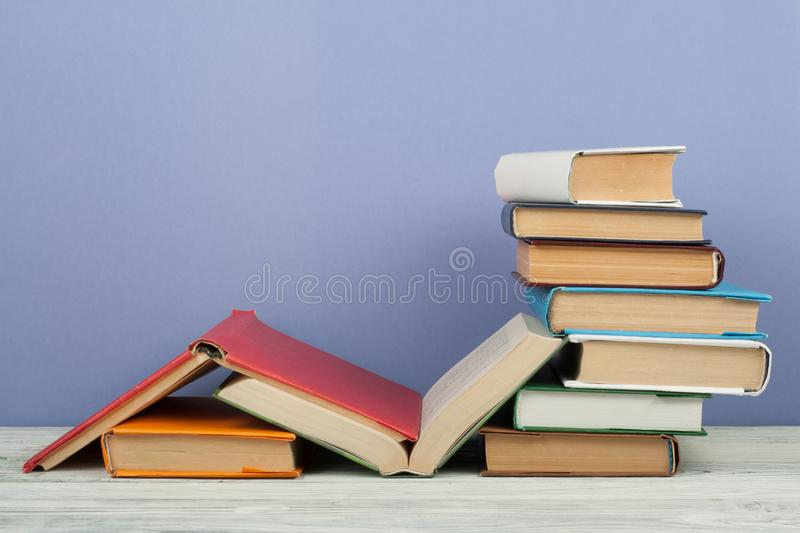 Open book, hardback colorful books on wooden table. Back to school. Copy space for text. Education business concept. stock photography
