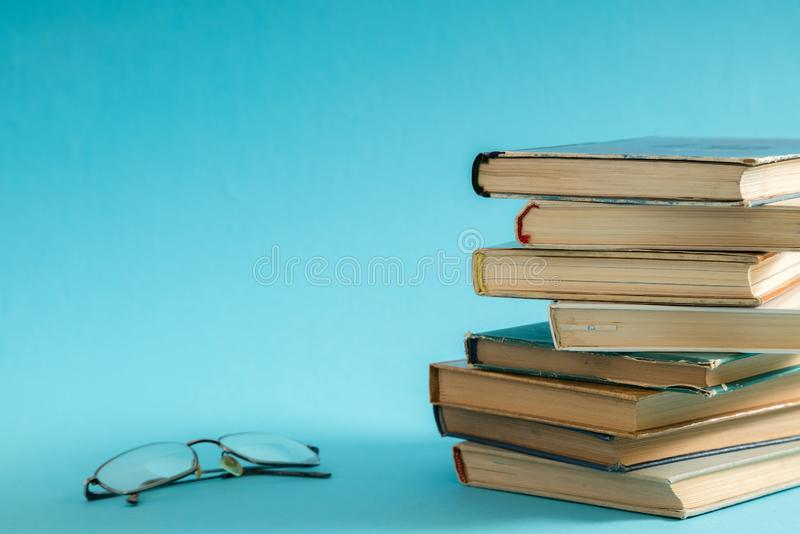Open book, hardback hard cover colorful books with reading glass. Es on the side. Back to school. Copy space for text. Education, studying, learning, business royalty free stock images