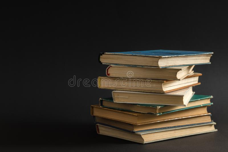 Open book, hardback hard cover colorful books stacked on the tab. Le. Back to school. Copy space for text. Education, studying, learning, business concept stock images