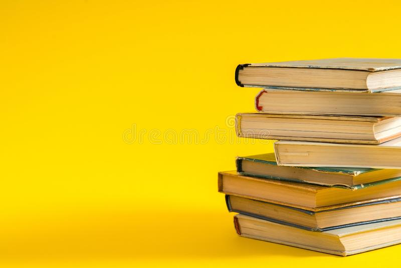 Open book, hardback hard cover colorful books stacked on the tab. Le. Back to school. Copy space for text. Education, studying, learning, business concept stock photos
