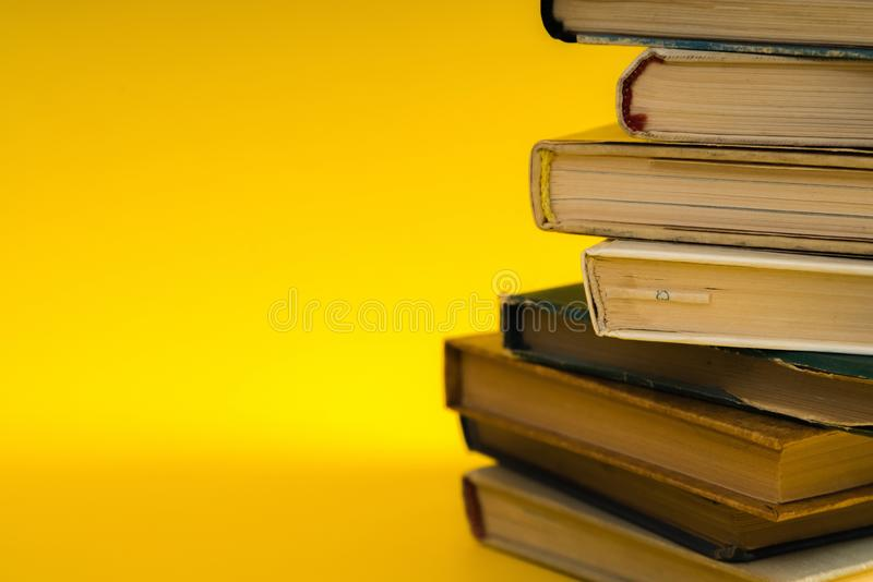 Open book, hardback hard cover colorful books stacked on the tab. Le. Back to school. Copy space for text. Education, studying, learning, business concept royalty free stock photo
