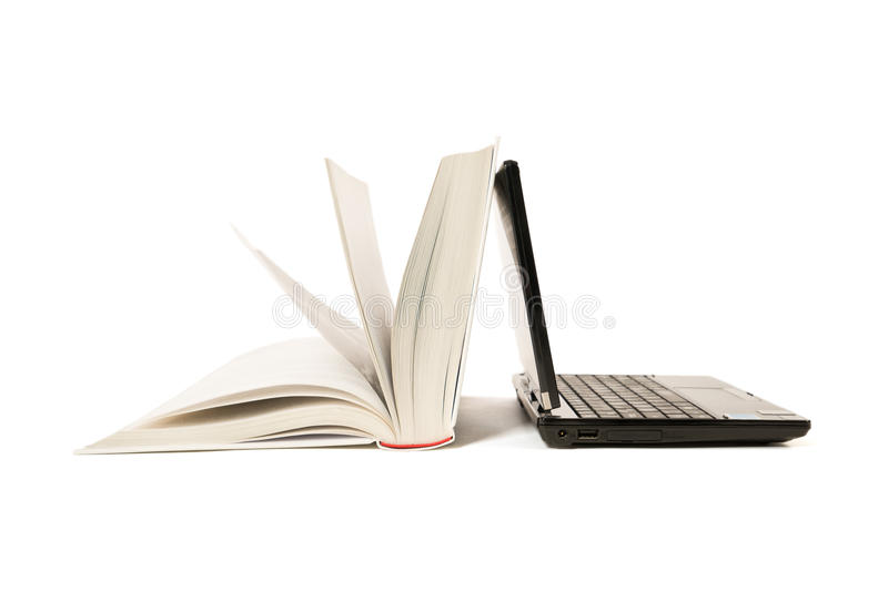 Open book and laptop stock image