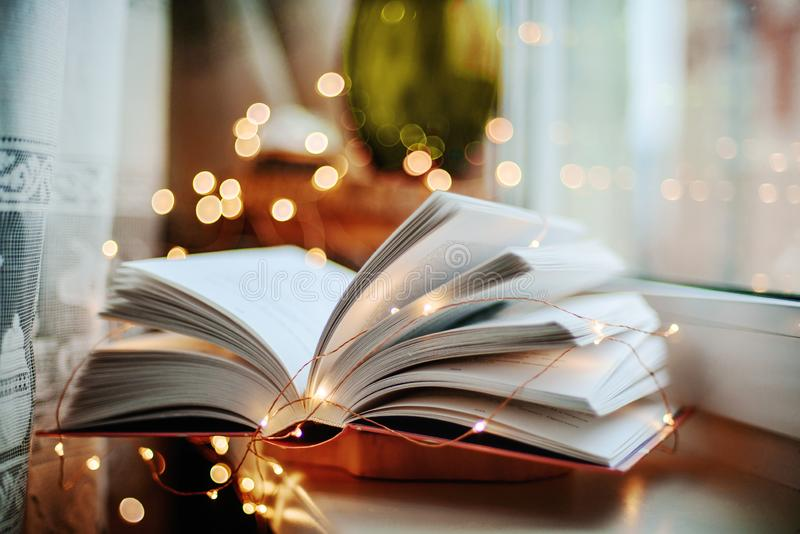 Open book with lights royalty free stock image