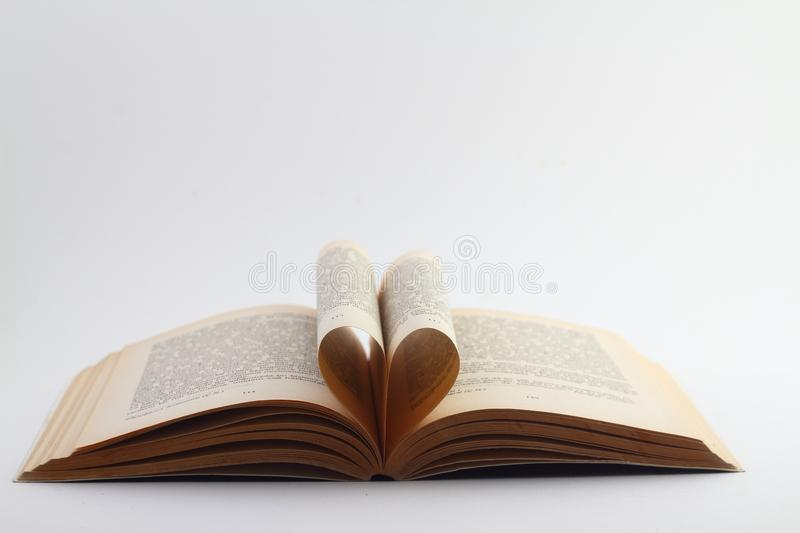 Open book lying on a white background royalty free stock photos