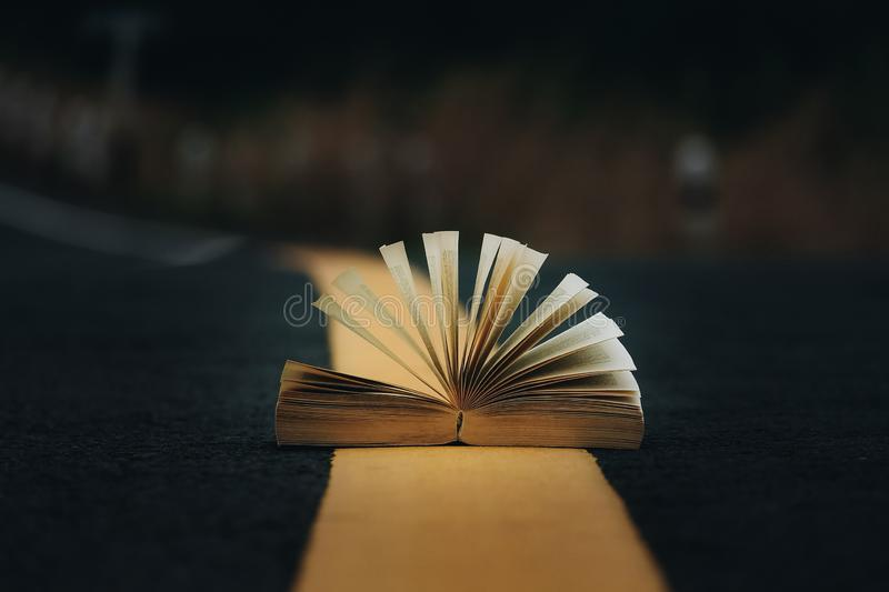 Open book on the middle of the road stock photos