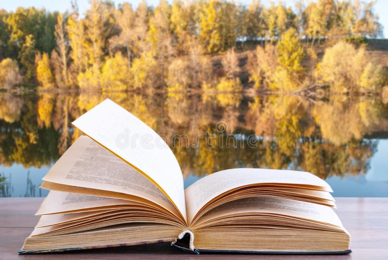 Open book on the background of nature royalty free stock photo