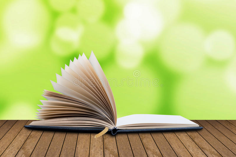 Open book, note lists of pages on move. On wood table stock photos