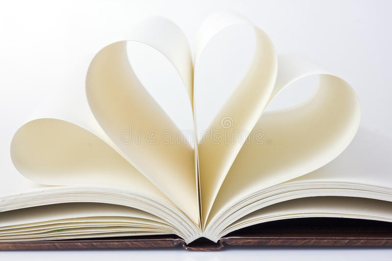 Open book with the pages in the form of heart. Blank pages of the book in the form of waves stock image