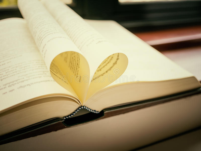 Open book with pages shaped like heart royalty free stock images