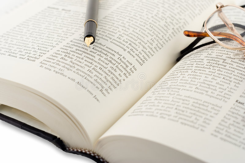 Open book and pen stock image