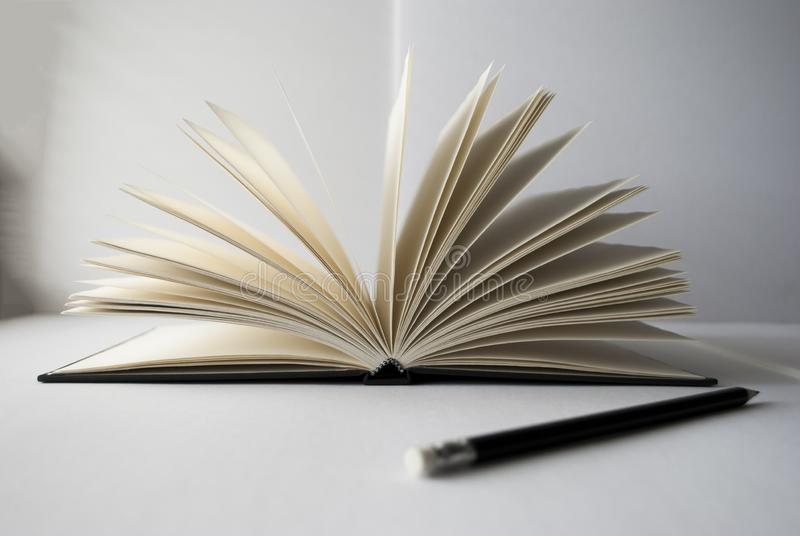Open book and pencil close up royalty free stock photos