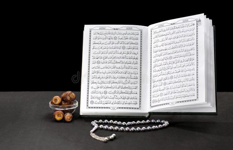 Open Book of Quran With Rosary and Dates stock photos