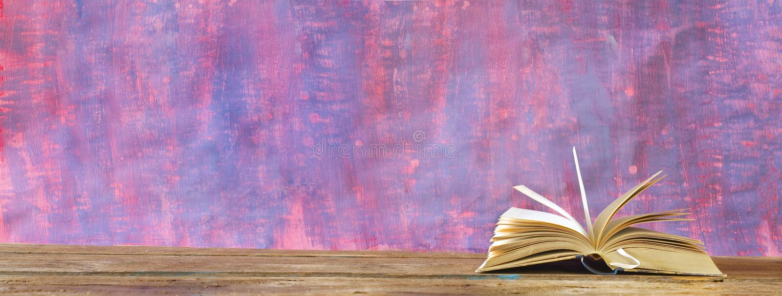 An open book. Reading, learning, education, literature concept, panoramic format, grungy background,copy space. An open book. Reading, learning, education royalty free stock image