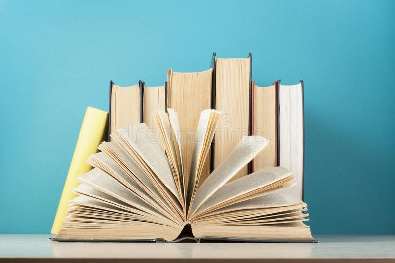 Open book, row of books on wooden table. Education background. Back to school. royalty free stock photography