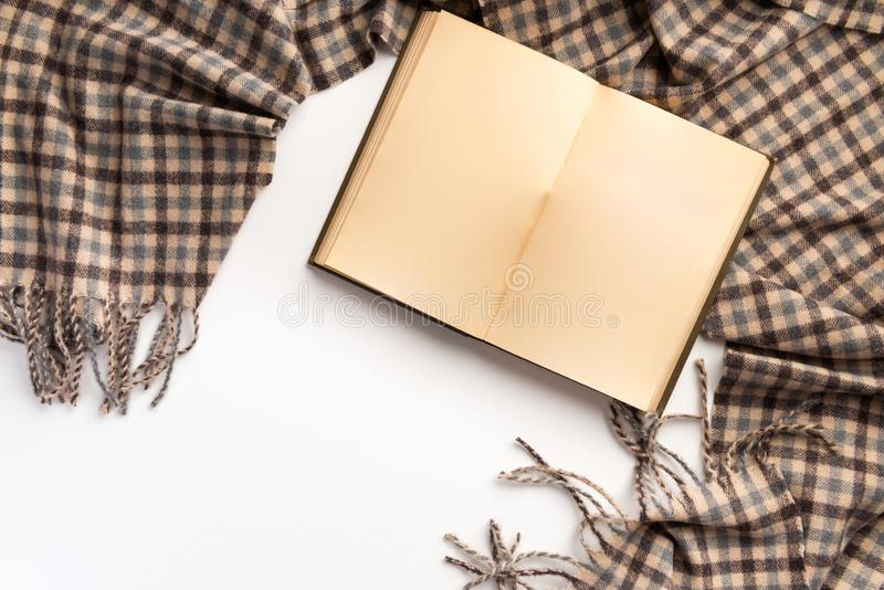 Open book and scarf, on a white background royalty free stock image