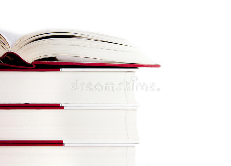 Open book on a stack of books stock photos