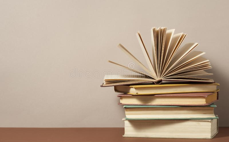 Open book and stack of books on wooden table. Education background. Back to school.Copy space for text. royalty free stock images