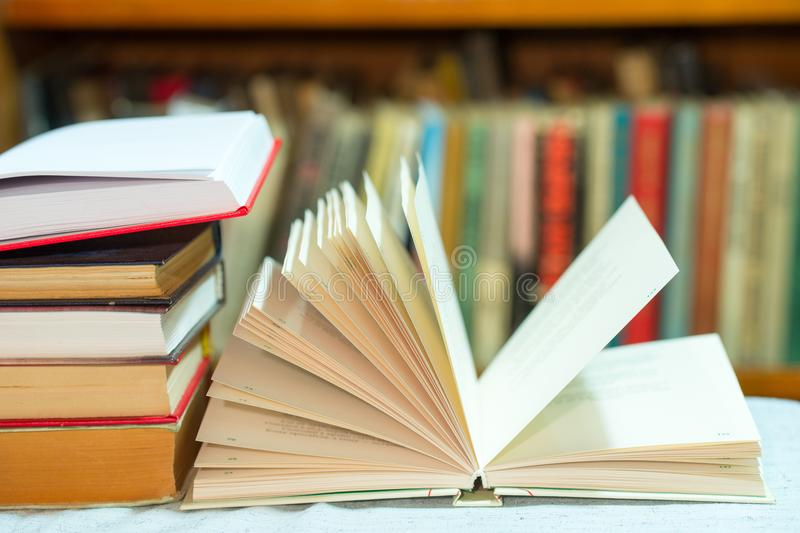 Open book, stack of hardback books on table. Top view. Open book, stack of hardback books on table. Back to school. Copy space. Top view royalty free stock photo