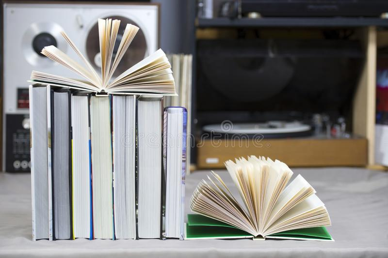 Open book, stack of hardback books on table. Top view. Open book, stack of hardback books on table. Back to school. Copy space. Top view royalty free stock images
