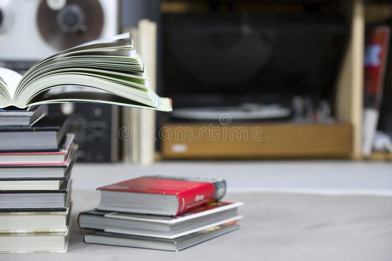 Open book, stack of hardback books on table. Top view. Open book, stack of hardback books on table. Back to school. Copy space. Top view stock photography
