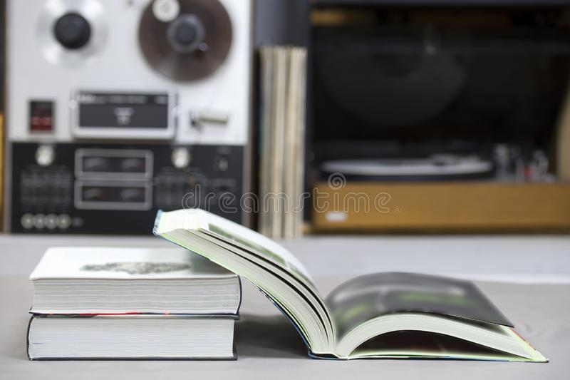 Open book, stack of hardback books on table. Top view. Open book, stack of hardback books on table. Back to school. Copy space. Top view stock photo