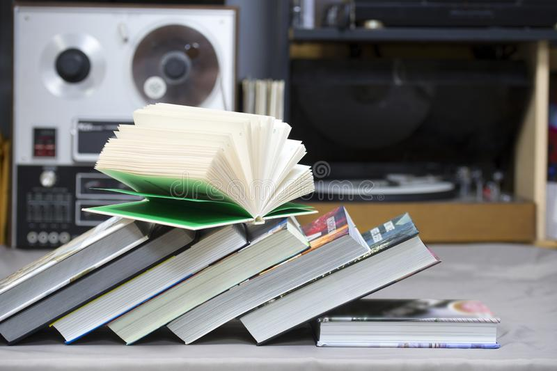 Open book, stack of hardback books on table. Top view. Open book, stack of hardback books on table. Back to school. Copy space. Top view royalty free stock image