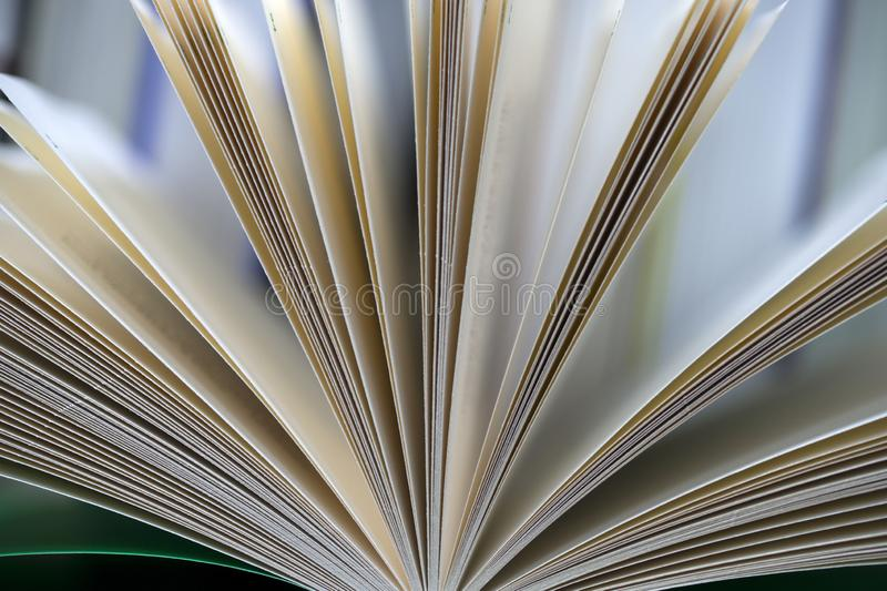 Open book, stack of hardback books on table. Top view. Open book, stack of hardback books on table. Back to school. Copy space. Top view stock images