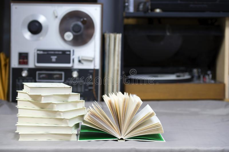 Open book, stack of hardback books on table. Top view. Open book, stack of hardback books on table. Back to school. Copy space. Top view stock photos