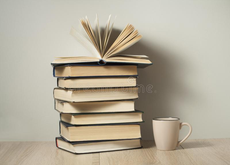 Open book , stack of old books and cup of coffee on wooden desk Back to school. Education background. stock photo