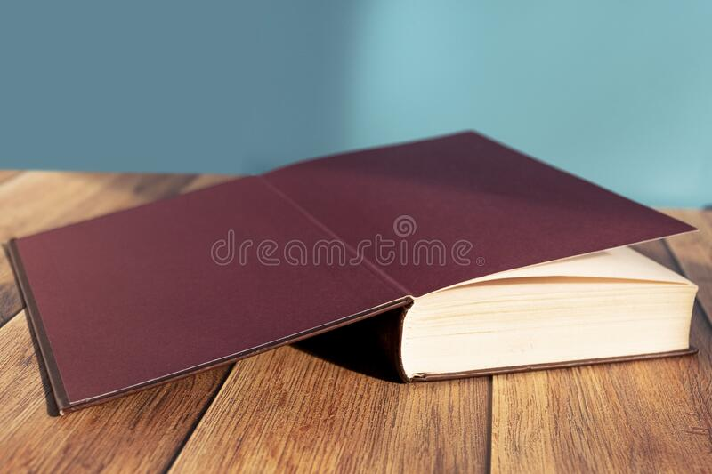 Open book on the table. A stack of old books with yellow pages. Book binding. Knowledge and education. stock photography