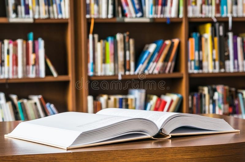Open book on the table stock photos