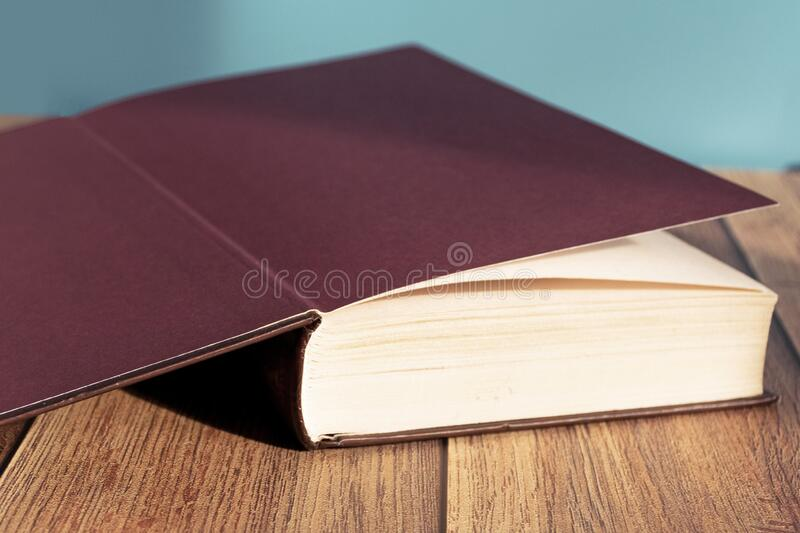 Open book on the table. A stack of old books with yellow pages. Book binding. Knowledge and education. royalty free stock photos