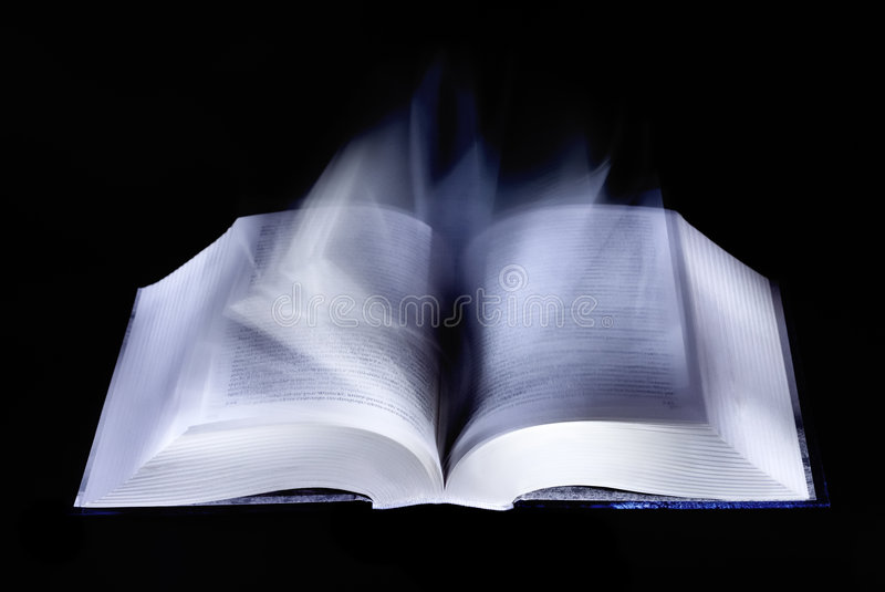 Open book and turning pages royalty free stock photo