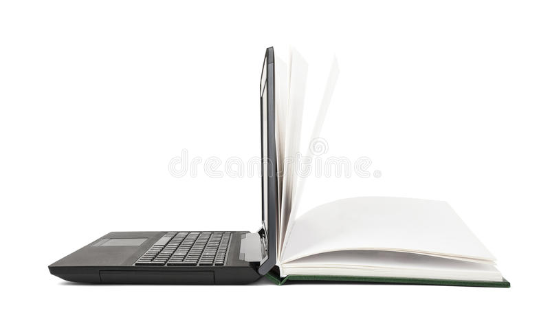 Open book turns into an open laptop royalty free stock photo