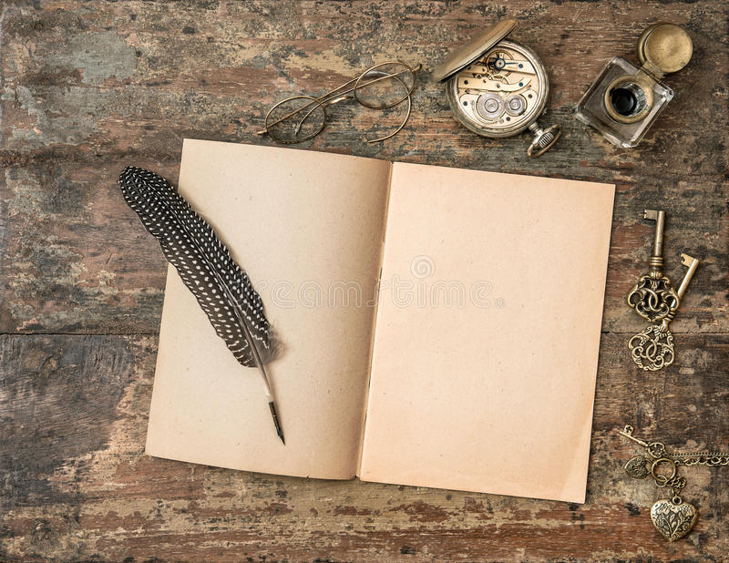 Open Book And Vintage Writing Accessories. Textured Wooden